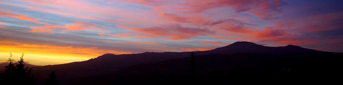 Colourful dawn sky behind Mount Amiata.
