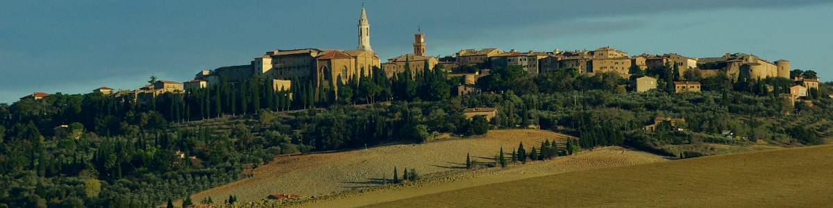 Buildings from the Renaissance period in Pienza tower over the surrounding countryside.